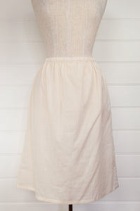 Handloom cotton voile lady's petticoat half slip in nude, elasticated waist and French seams.
