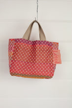 Load image into Gallery viewer, Létol made in France organic cotton reversible mini tote bag lunch bag, jacquard pattern in dot design in shades of red, pink and orange with highlights in olive, co-ordinating pattern in shades of pink on the reverse.