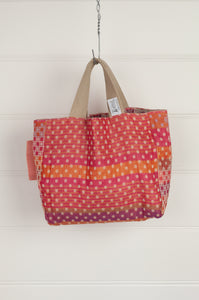 Létol made in France organic cotton reversible mini tote bag lunch bag, jacquard pattern in dot design in shades of red, pink and orange with highlights in olive, co-ordinating pattern in shades of pink on the reverse.