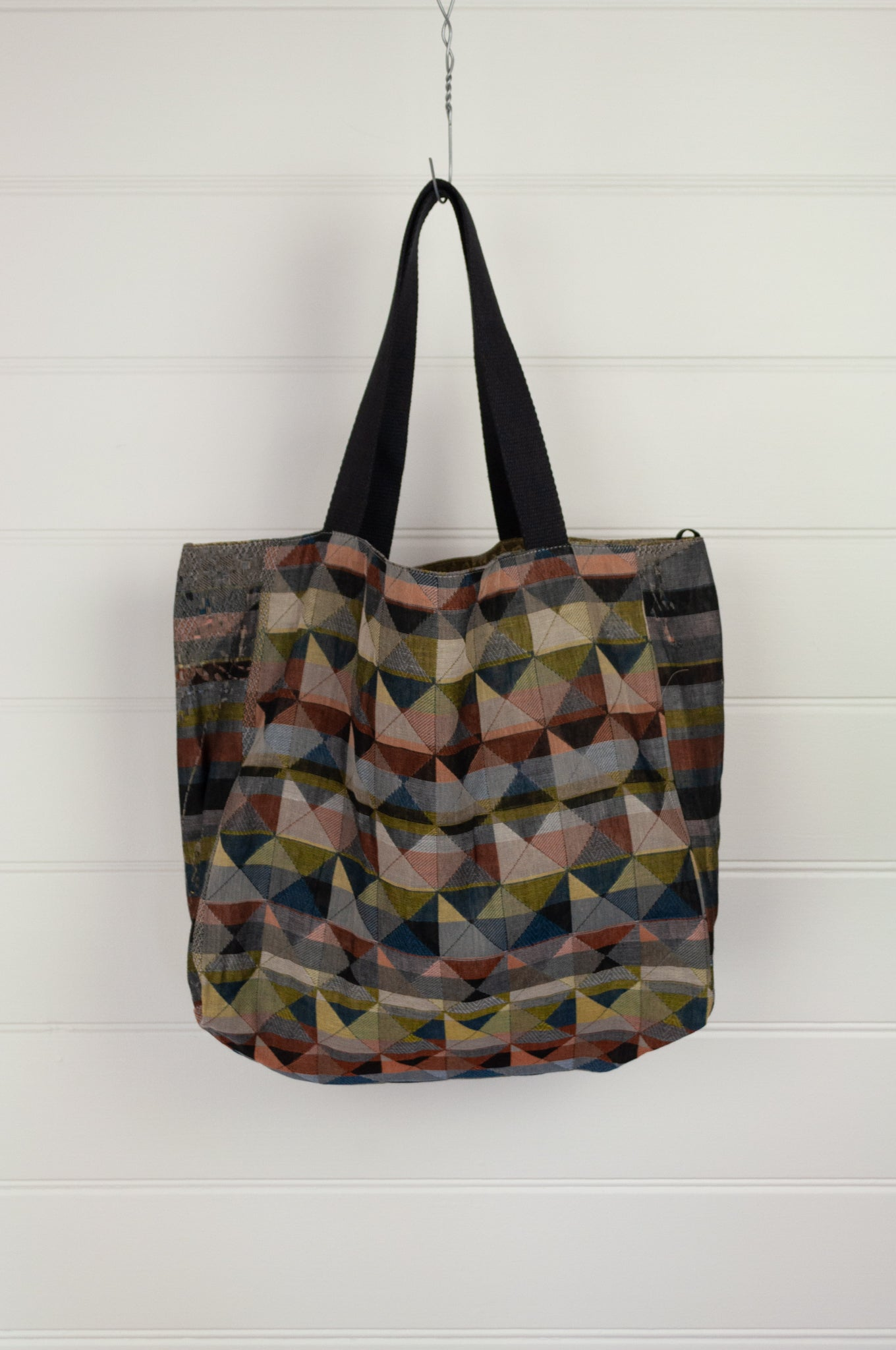 Létol made in France from organic cotton, reversible tote bag medium size with graphic Missoni-inspired Milan design in rich multi-colours, with co-ordinating graphic olive and gold print on the reverse.