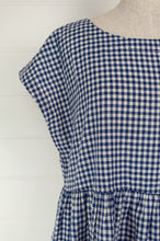 Load image into Gallery viewer, DVE blue and white gingham check Toshni dress in handloom cotton, easy fit round neck short sleeve bodice with gathered skirt and in seam pockets.