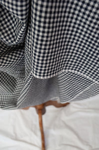 DVE black and white gingham check Toshni dress in handloom cotton, easy fit round neck short sleeve bodice with gathered skirt and in seam pockets, selvedge hem detail.