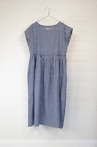 DVE blue and white gingham check Toshni dress in handloom cotton, easy fit round neck short sleeve bodice with gathered skirt and in seam pockets.