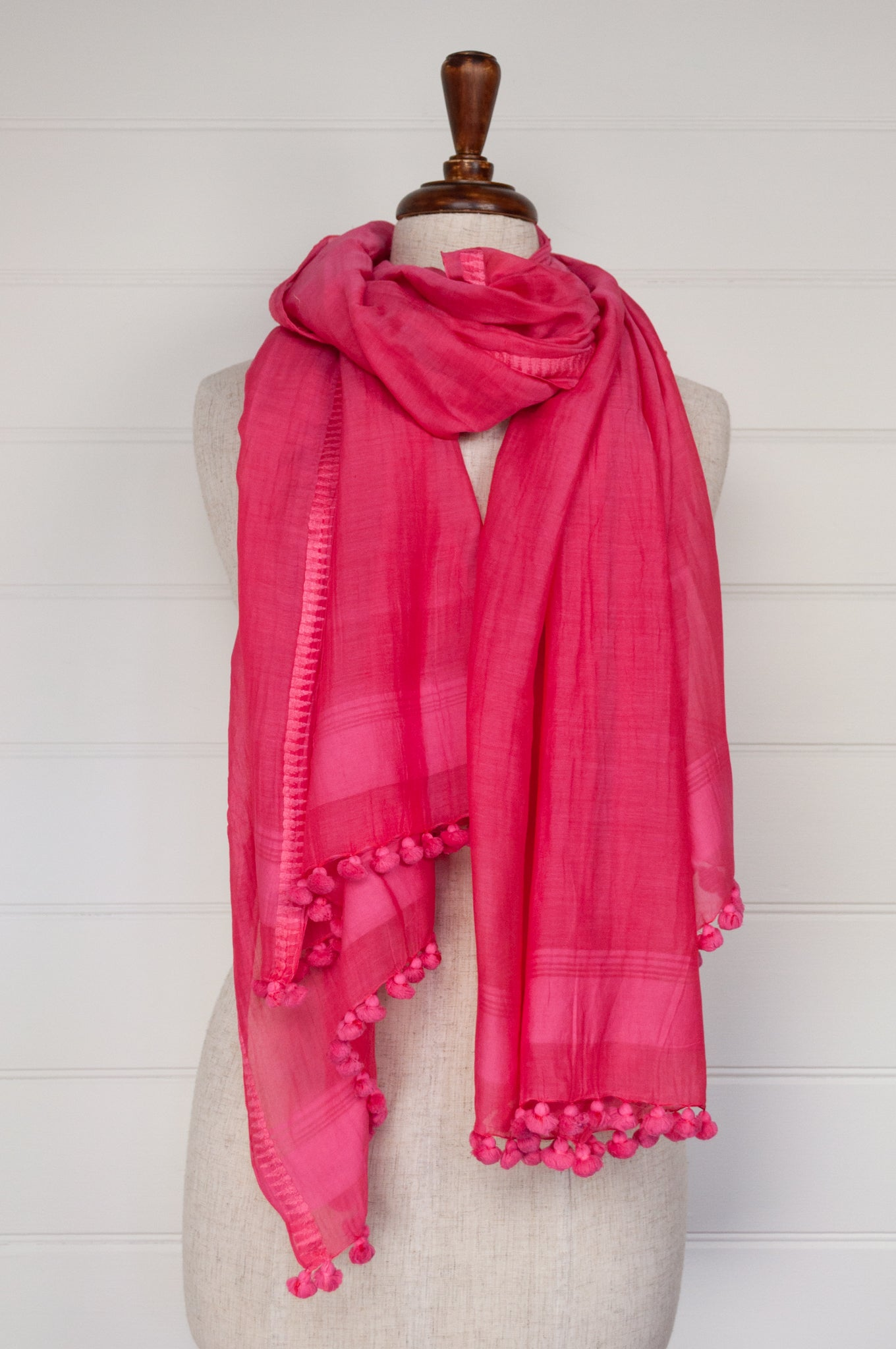 Silk cotton pompom scarf in hot pink.