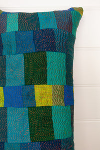 Vintage silk patchwork kantha bolster cushion in shades of teal, jade, turquoise, aqua and highlights of olive green.
