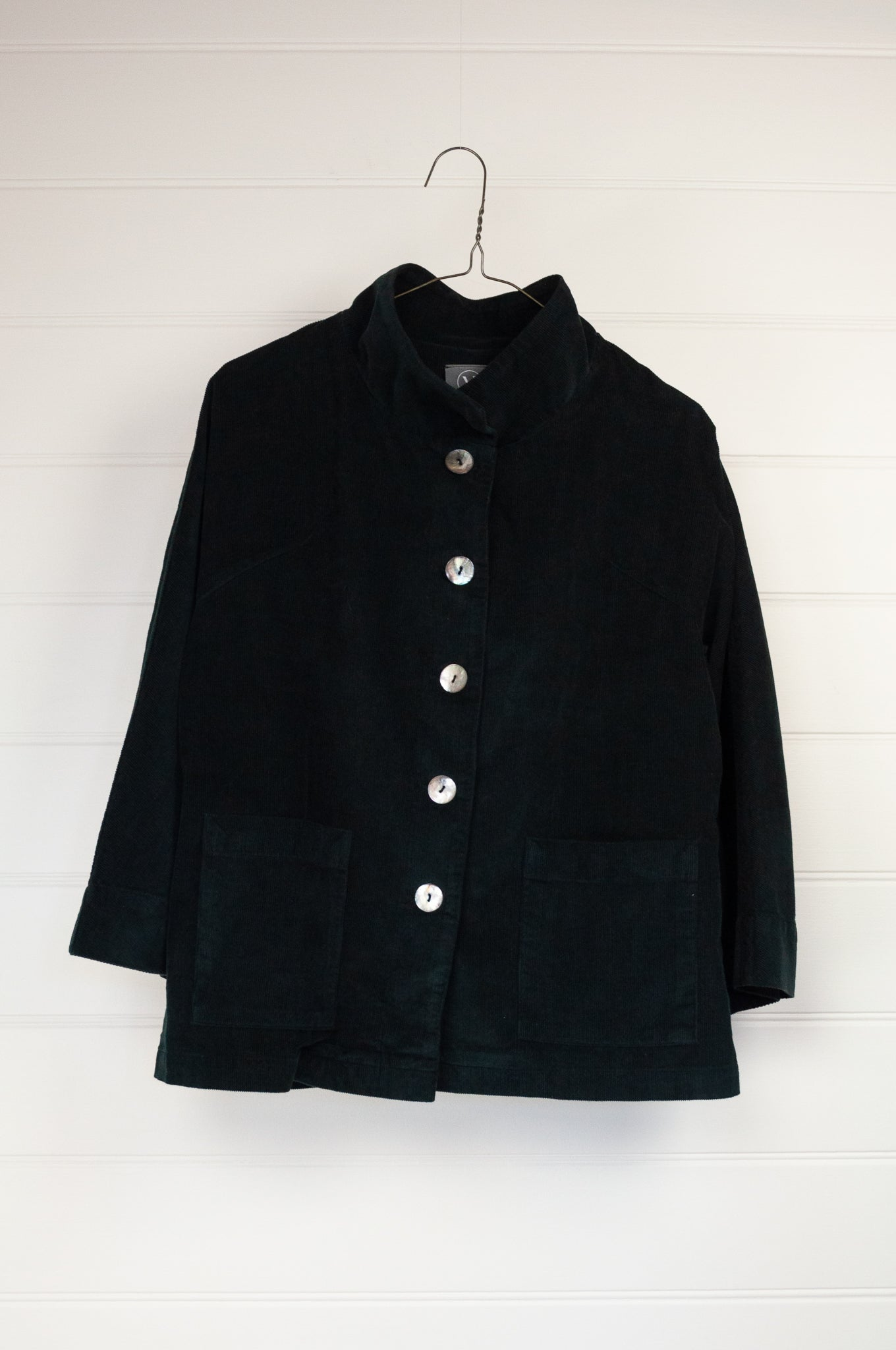 Valia Fitzroy jacket, ethically made in Melbourne from fine black cotton corduroy, shell buttons, funnel collar and front patch pockets.
