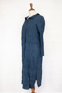 Maku one size Kapota dress in crushed handwoven cotton, deep indigo with black stripe, long sleeve, button bodice and asymmetrical collar.