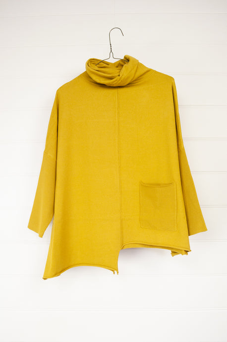 Banana Blue 1836PV poly voly pullover in mustard, roll neck, easy fit asymmetrical hem and front patch pocket.