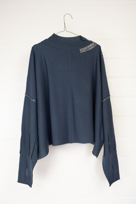 Banana Blue fine merino wool pullover in steel blue with hand stitched details in ecru.