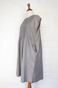 Dve pure boiled wool mid grey pin tucked sleeveless Rima pinafore dress.