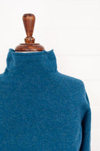 Load image into Gallery viewer, Eribe made in Scotland Corry raglan sweater, relaxed fit 100% merino wool, in Mallard, teal green blue.