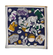 Load image into Gallery viewer, Inouitoosh silk and modal square scarf 130 x 130 cm, Piotr, depicting gems and uncut gems on a navy background in shades of mustard gold, amethyst  and emerald.
