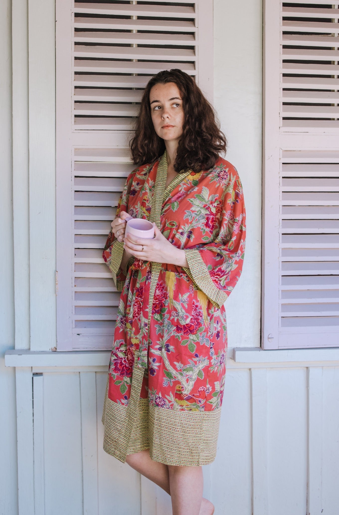 Cotton voile kimono robe dressing gown in coral bird print with yellow trim.