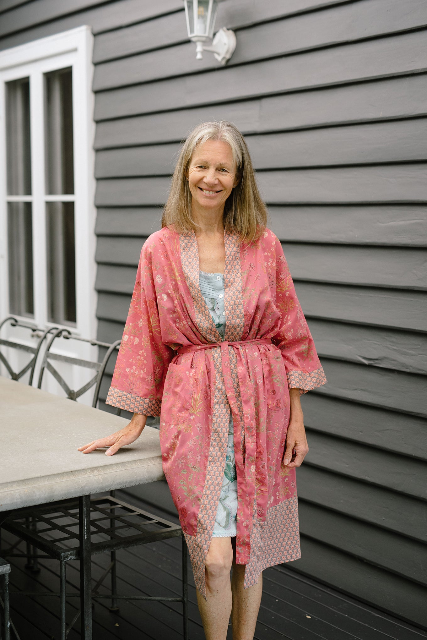 Ethically made, cotton voile kimono robe dressing gown in deep raspberry pink floral print.