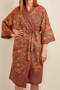 Cotton voile kimono robe dressing gown in a rust red palm print with red and blue matching geometric trim.