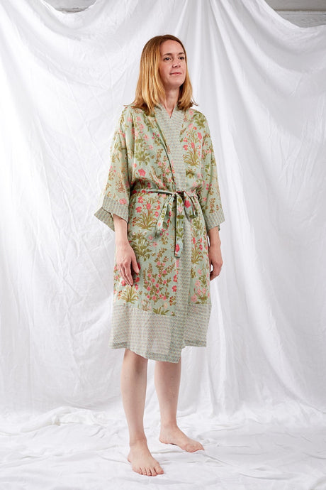 Ethically made cotton voile kimono robe dressing gown in a mint green floral print with pink highlights, and matching trim.