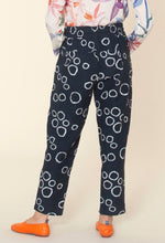 Load image into Gallery viewer, Nancybird Terrain pant in black and white circle print, 50% cotton and 50% linen (rear view).
