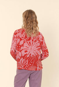 Nancybird Spinifex easy fit raglan top in pure silk, hand drawn print pink on red.