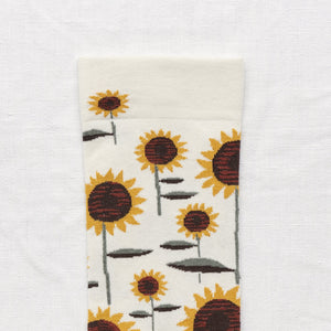 Bonne Maison fine cotton socks, made in France. Natural sunflowerDark, Umber Brown and Buttercup Yellow Sunflower on Natural background with Sage Green toe.