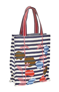Inouitoosh canvas tote bag in the Aout design, featuring red and pink flowers on blue and white stripes.