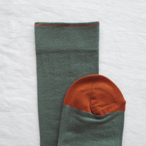 Bonne Maison fine cotton socks made in France, co-ordinating cedar green plain with pumpkin orange toe and edging.