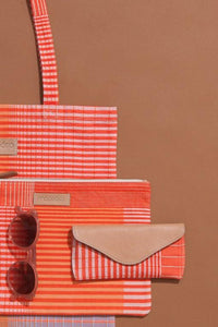 Ma Poesie cotton canvas zippered pouch in Gradient print in orange and pink stripes and checks.