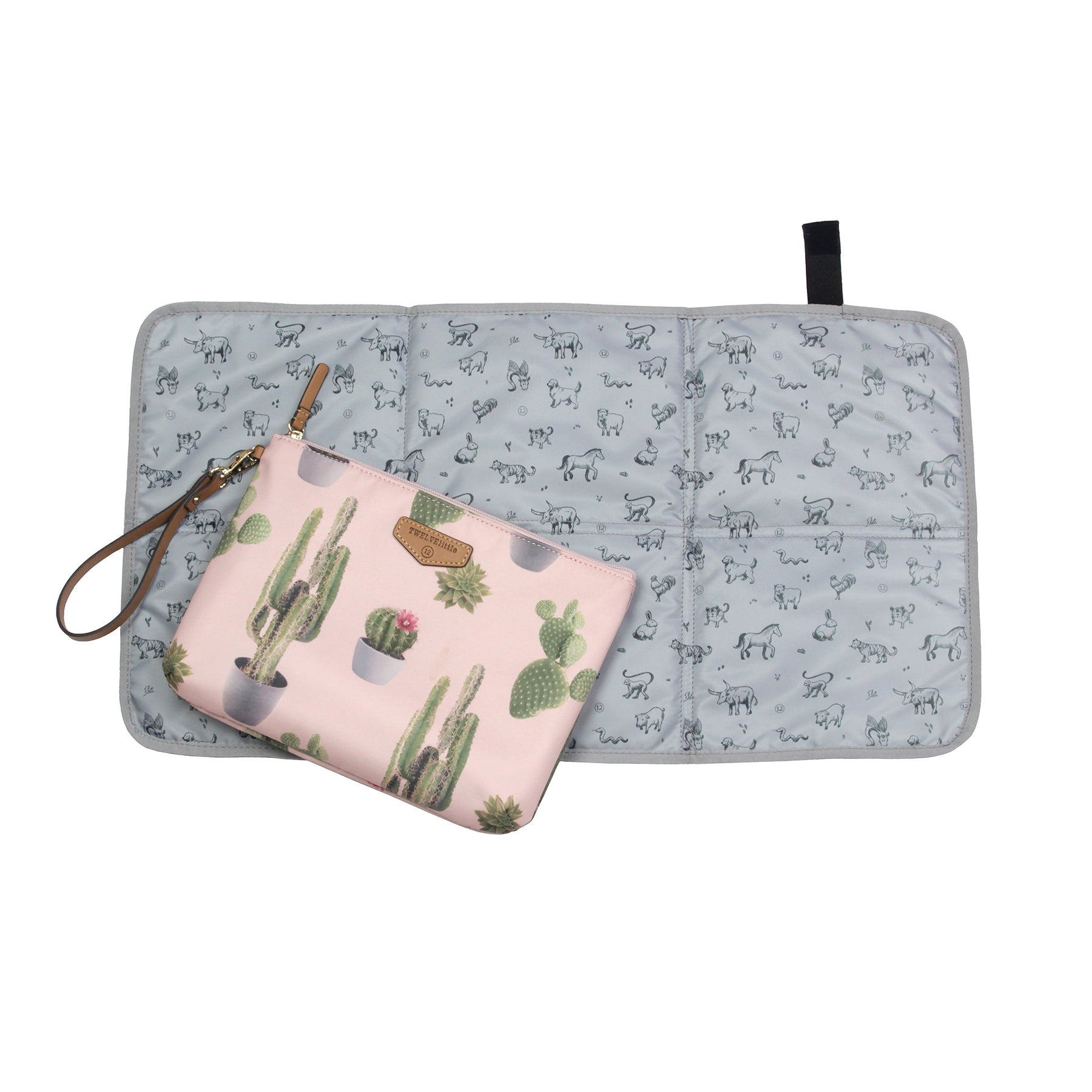 Changing pad laid out with cactus diaper pouch laying on top