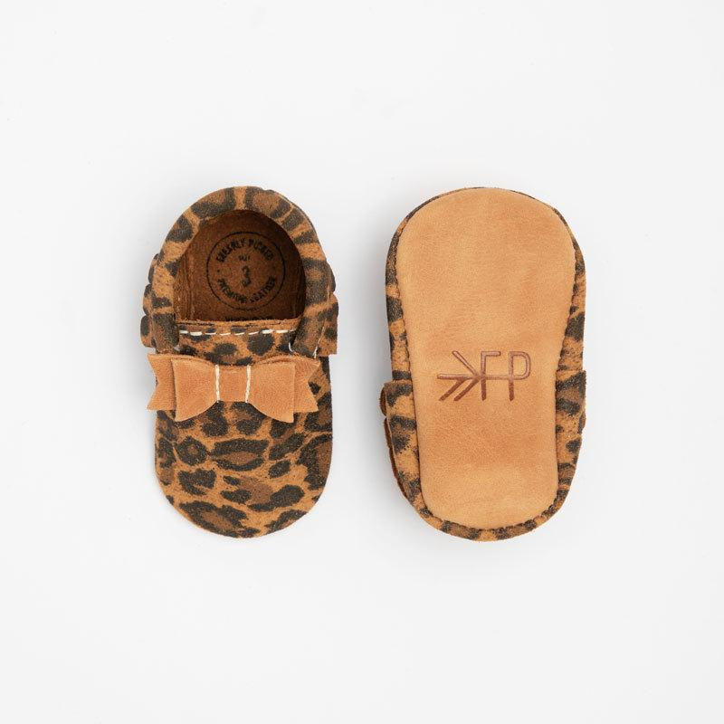 Top and bottom view of  leopard moccasins