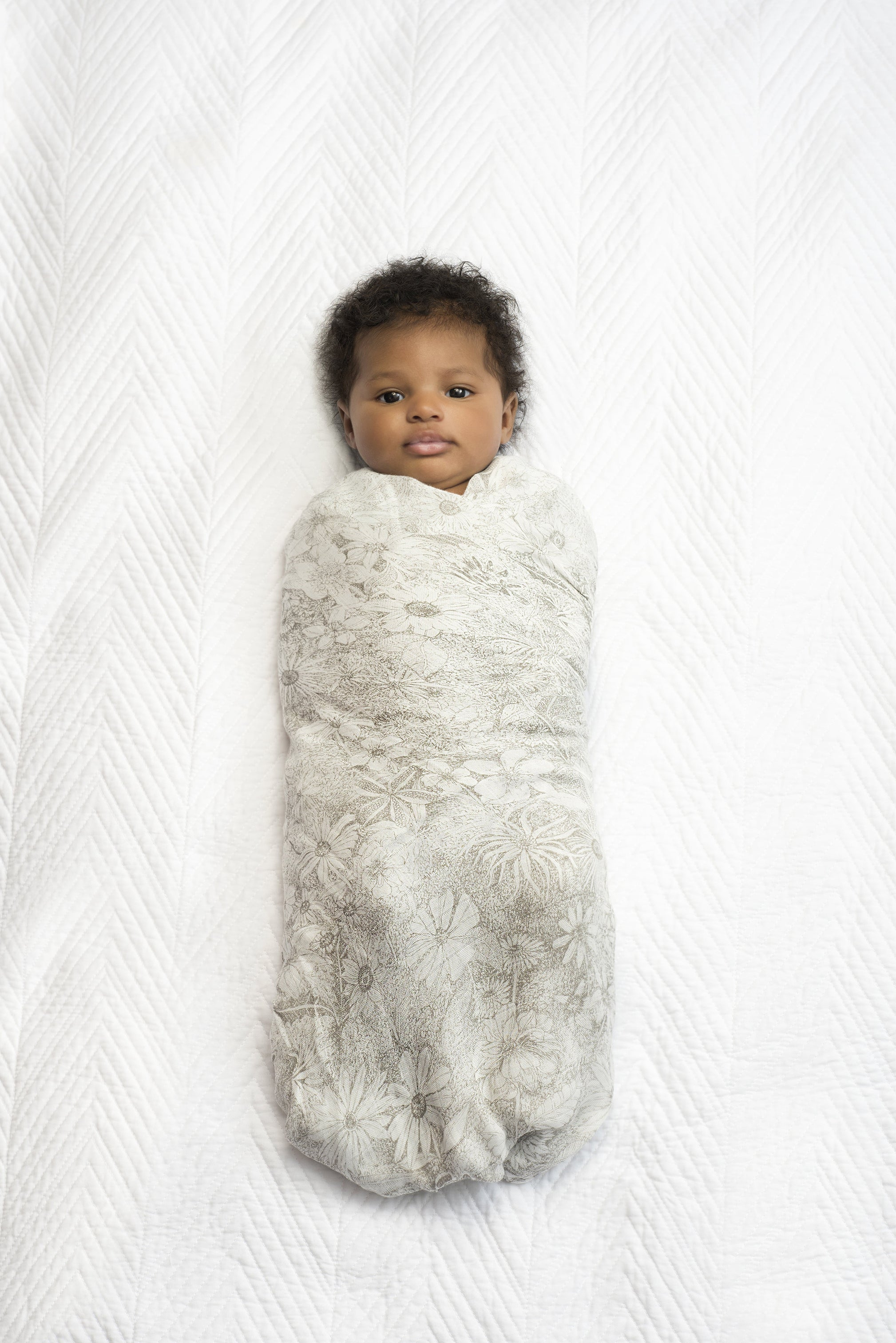 Baby wrapped in a featherlight silky soft swaddle.