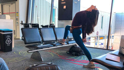 5 Yoga Poses for a Long Layover at the Airport