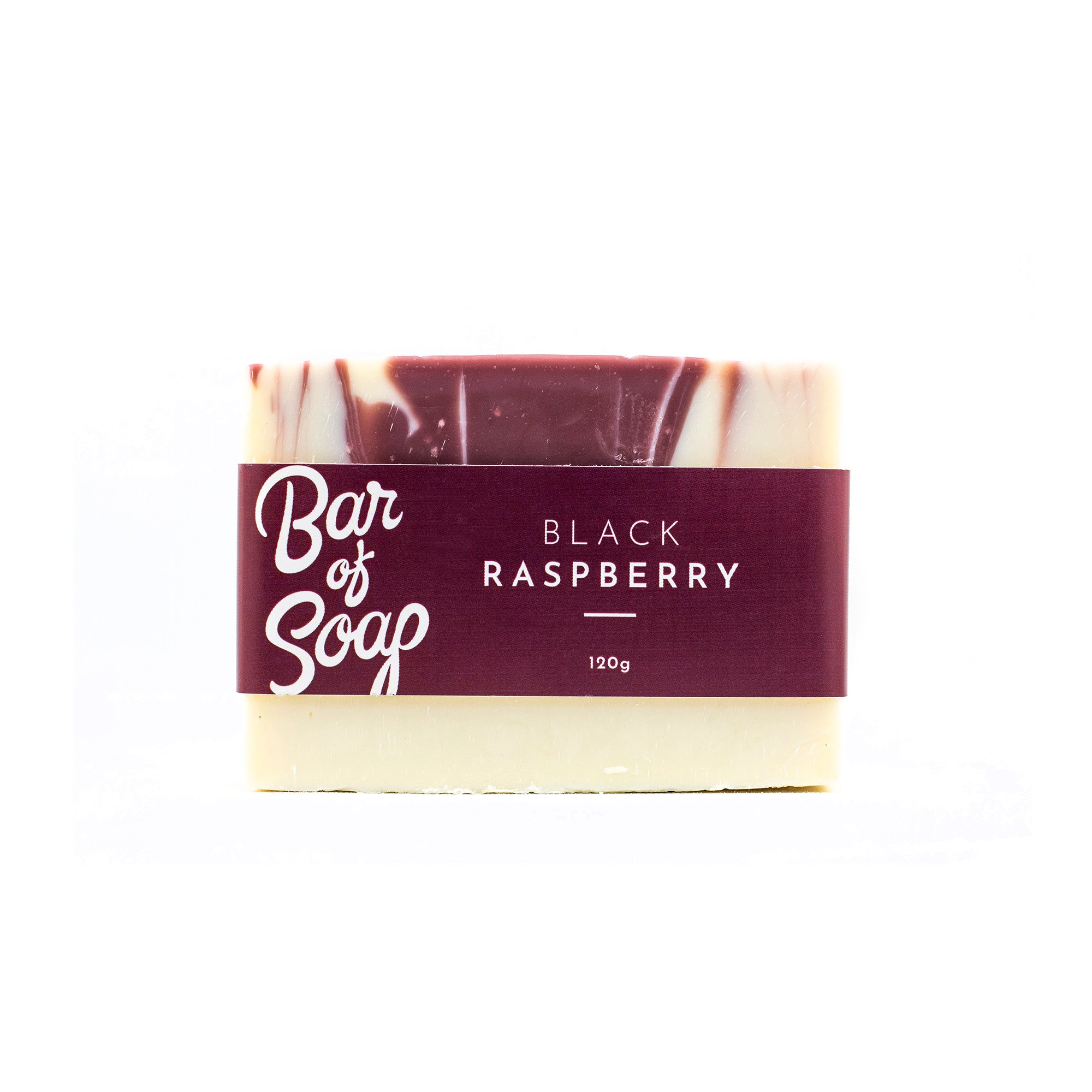 A white bar of soap with a maroon coloured drop swirl in its centre. The bar of soap is labeled with a black raspberry Bar of Soap label.