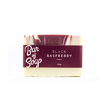 Load image into Gallery viewer, A white bar of soap with a maroon coloured drop swirl in its centre. The bar of soap is labeled with a black raspberry Bar of Soap label.