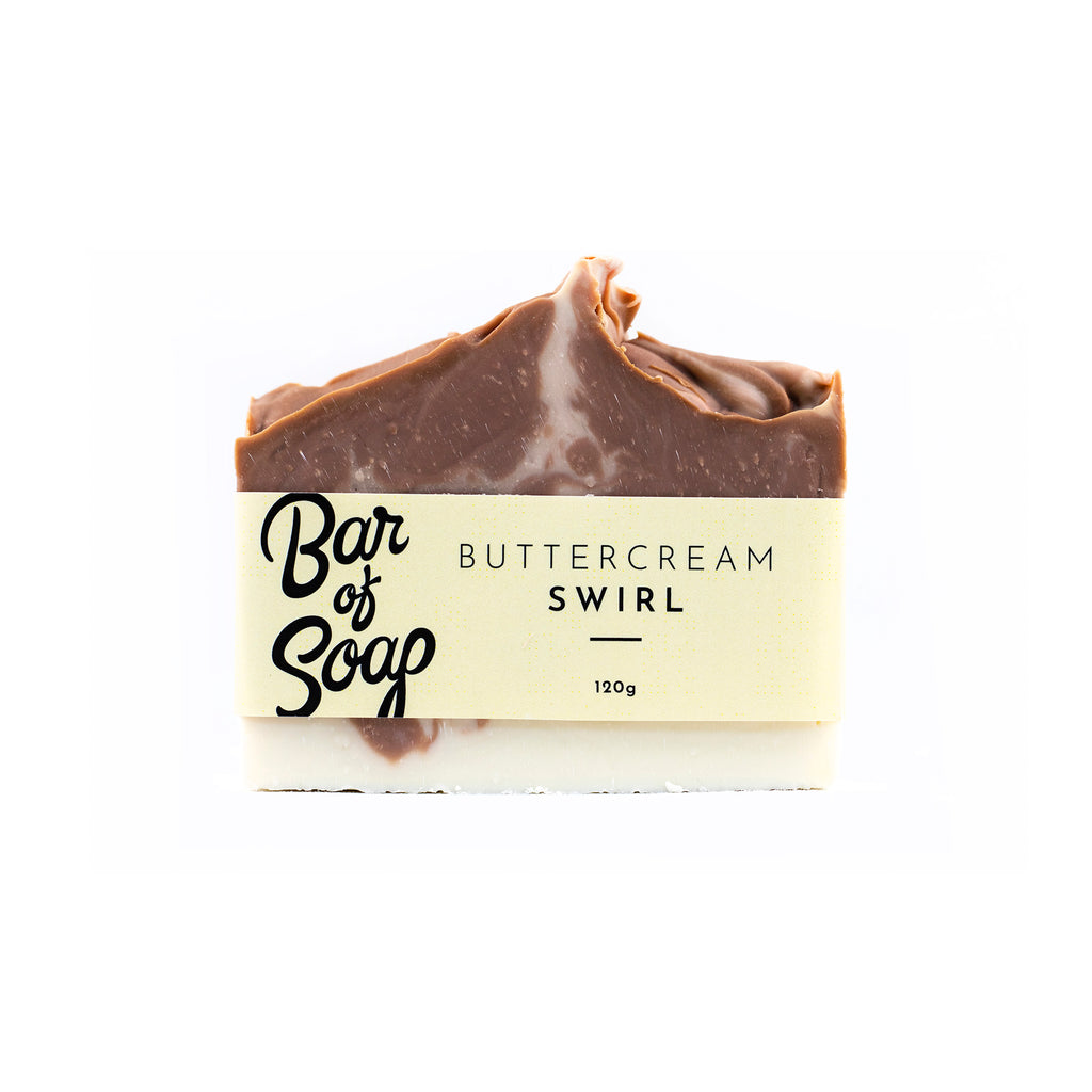 Brown and white swirled bar of soap with textured top labelled with a buttercream swirl Bar of Soap label on a white background.