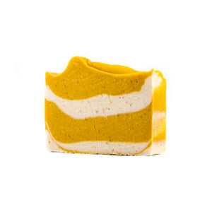 A soft yellow and white mixed in uneven layers of a bar of soap.