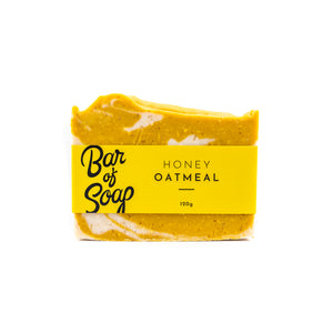 A soft yellow and white mixed in uneven layers of a bar of soap. It is labeled with a yellow Honey Oatmeal Bar of Soap label.