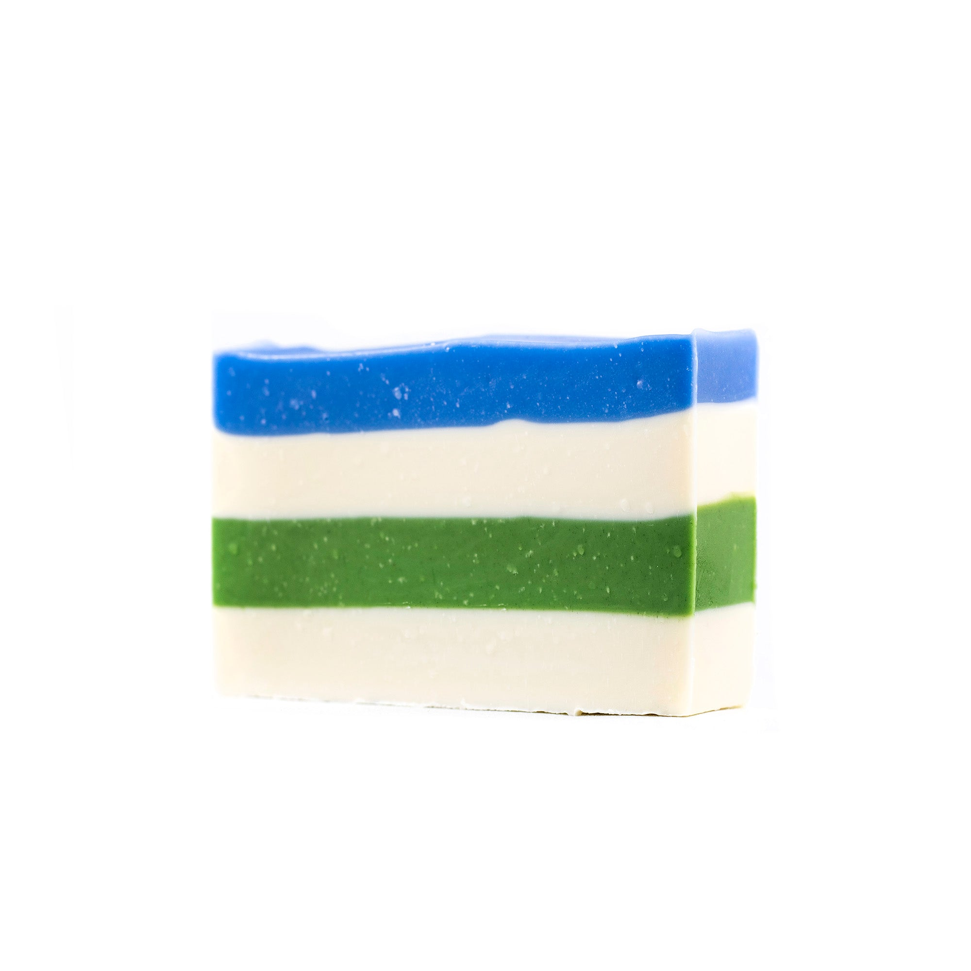 A layered soap starting with blue, stacked on top of white, followed with a forest green and finishing of the bottom layer with white.
