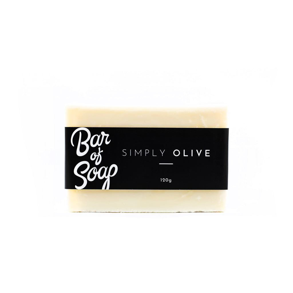 A simple and white pure olive oil bar of soap with a Simply Olive Bar of Soap label.