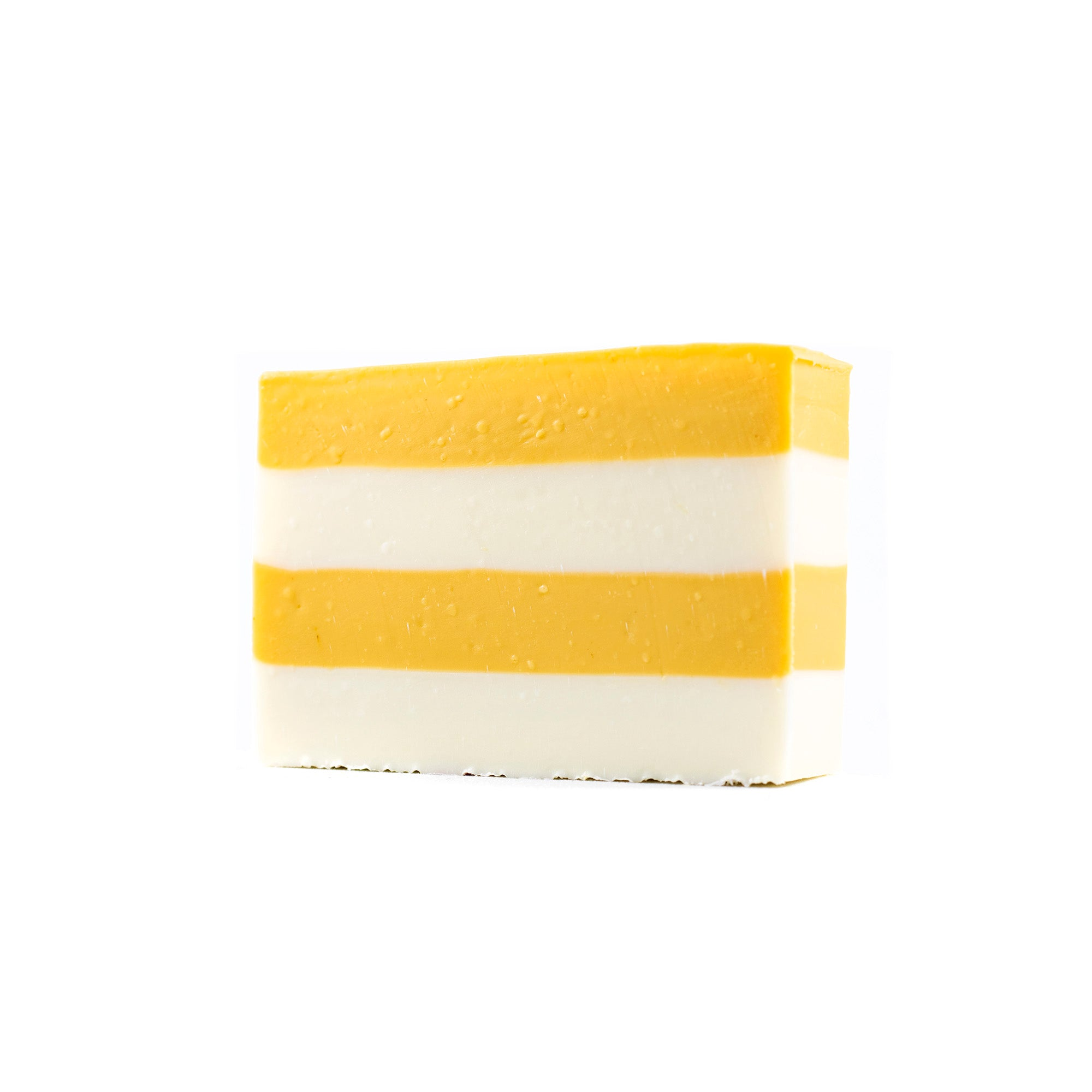4 alternating layers of yellow and white in a banana coconut scented Bar of Soap.