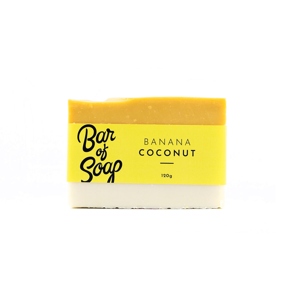 A layered yellow and white Bar of Soap with a banana coconut Bar of Soap label.