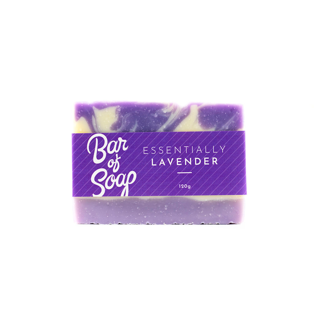 A swirled lavender and white Bar of Soap with a solid lavender layer making up the bottom 8th of the bar. The bar of soap is wrapped with a Essentially Lavender Bar of Soap label