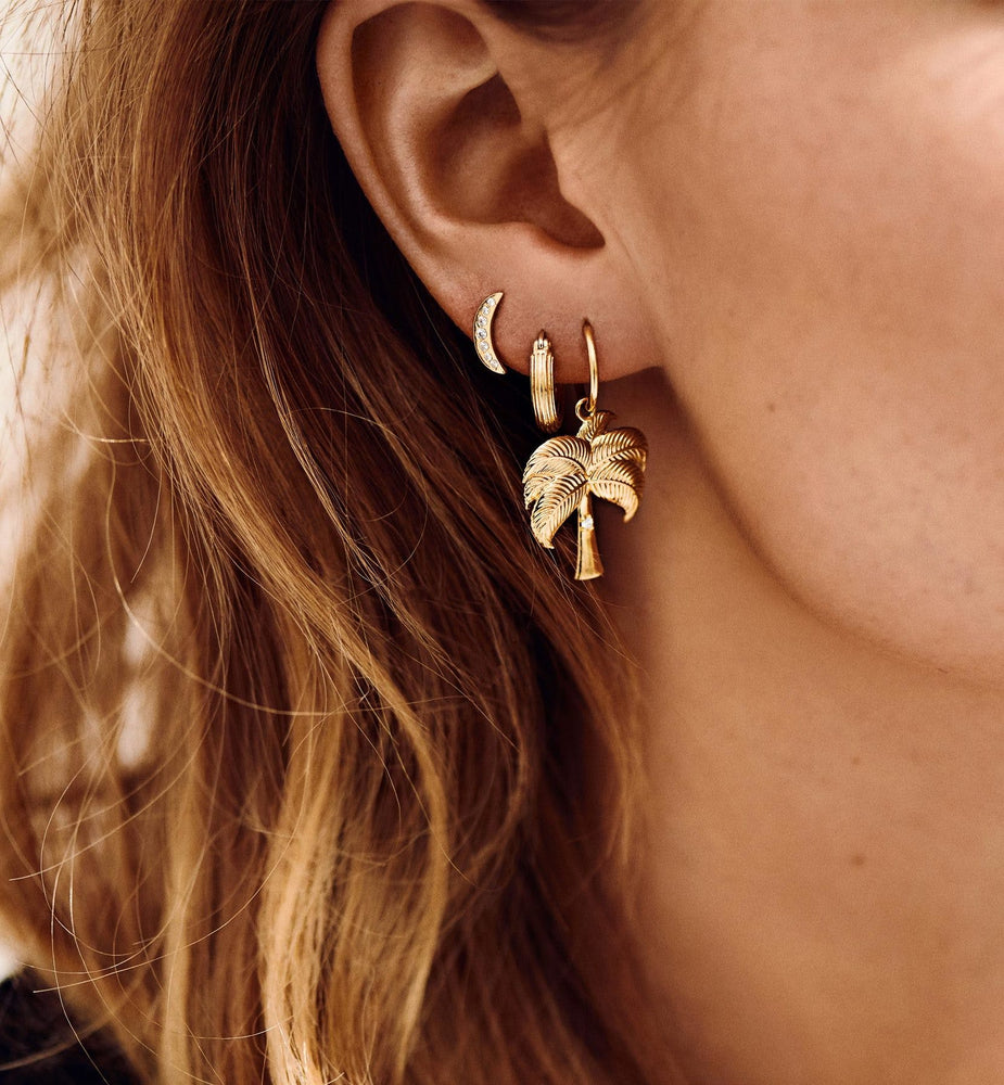 ANNA + NINA Single Twinkling Palm Ring Earring