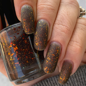 black thermal nail polish, black to clear, ucc flakie topper, red to gold to green, hunger games, swamp gloss, hunger games inspired nail polish, fandom, fandom nail polish, indie polish, flakie topper, thermal topper, swamp gloss polish