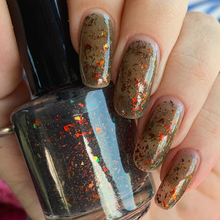 Load image into Gallery viewer, black thermal nail polish, black to clear, ucc flakie topper, red to gold to green, hunger games, swamp gloss, hunger games inspired nail polish, fandom, fandom nail polish, indie polish, flakie topper, thermal topper, swamp gloss polish