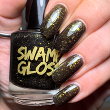 Load image into Gallery viewer, new orleans saints black crelly polish, gold green crystal chameleon flakes, scattered gold holo, indie polish, swamp gloss nail polish