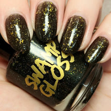 Load image into Gallery viewer, new orleans saints black crelly polish, gold green crystal chameleon flakes, scattered gold holo, indie polish, swamp gloss nail polish, jellybellynails