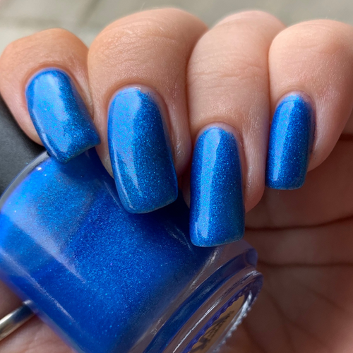 custom blue flakie nail polish with blue metallic micro flakes, deep violet micro flakes and aqua sparks