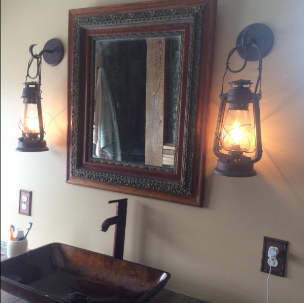 Muskoka Lifestyle products rustic lanterns hung next to a mirror
