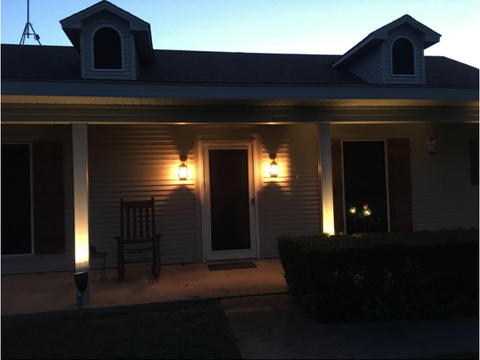 quality electric lanterns and infrared heaters this picture is of a house at night with two electric lanterns hanging by the front door