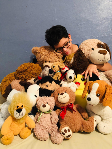 child with stuffed animals