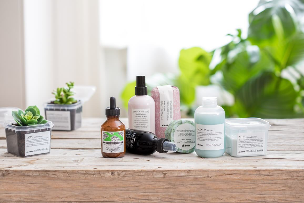 davines hair products sitting on a wooden table
